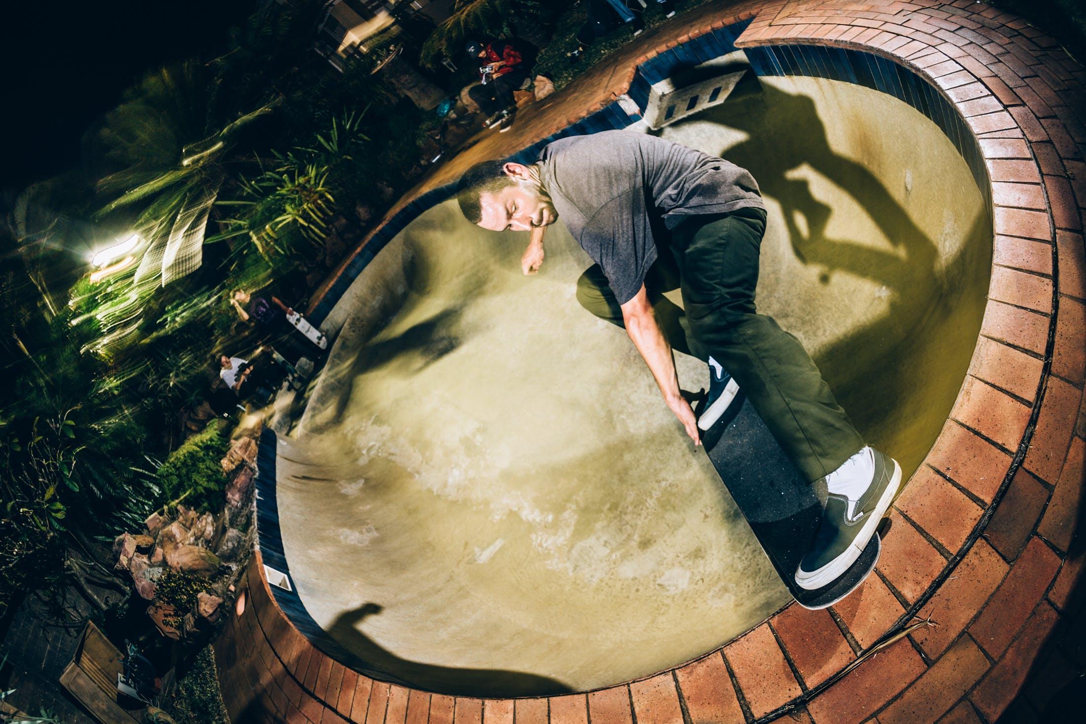 Sam Beckett skateboarding a backyard pool in durban