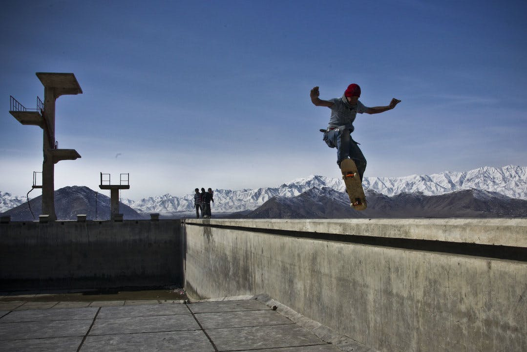 Children skating in an abandoned swimming pool in Afganistan